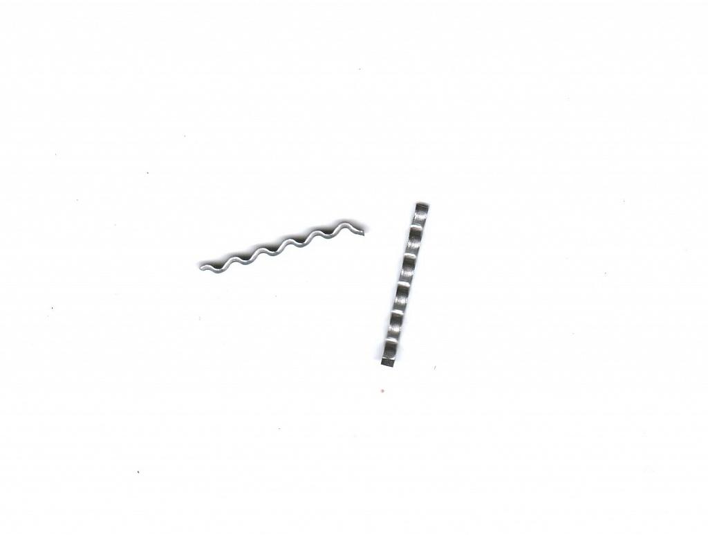 Стальная фибра, изготовленная из низкоуглеродистой проволоки.